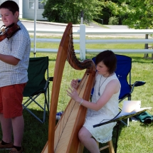Nicholas Trevits & Mary Lovegrove perform at the Craftsbury Farmers Market